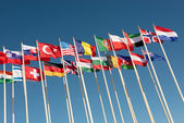Flags on flagpoles fluttering in the wind — Stock Photo