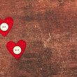 Two hearts and buttons on old shabby wooden background — Stock Photo #62874817