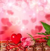 Valentinstag Hintergrund mit Herz, Süßigkeiten und rose — Stockfoto