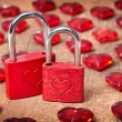 Vintage card with locks and red hearts on grunge old background — Stock Photo #64468781