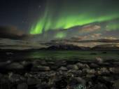 Northern Lights over the Arctic fjord - Svalbard — ストック写真