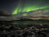 Northern Lights over the Arctic fjord - Svalbard — Zdjęcie stockowe