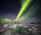 Unusual Arctic winter landscape - Frozen fjord & Northern Lights — Stock Photo