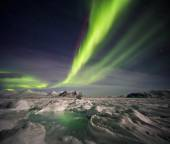 Unusual Arctic winter landscape - Frozen fjord & Northern Lights — Stock fotografie
