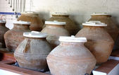 Earthenware jars in a olive oil museum — Stock Photo
