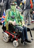 Green faced men on wheelchair — Stock Photo