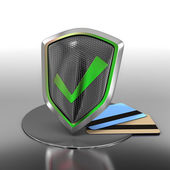 Bank credit cards secured with shield — Stock Photo