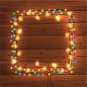 Glowing Christmas Lights Frame — Stock Vector