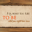 Inspirational quote on grunge paper against wood background — Stock Photo #64965311