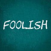 FOOLISH written on chalkboard — Stock Photo