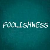 FOOLISHNESS written on chalkboard — Stock Photo