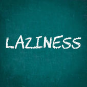 LAZINESS written on chalkboard — Stock Photo