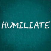 HUMILIATE written on chalkboard — Stock Photo