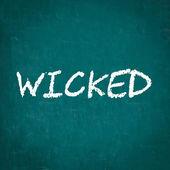WICKED written on chalkboard — Stock Photo