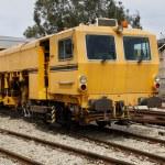 Yellow railway locomotive — Stock Photo #68610103