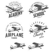 Light airplane related emblems, labels and design elements — Stock Vector