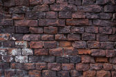 Old damaged red brick wall background — Stock Photo