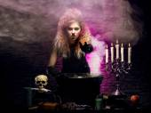 Young and beautiful witch in dungeon — Stock Photo