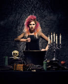 Beautiful witch making witchcraft — Stock fotografie