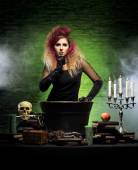 Beautiful witch making witchcraft — Stock Photo
