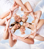 Large group of smiling teenage friends — Stock Photo