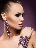 Young beautiful rich woman in jewels — Stock Photo
