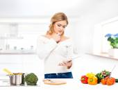 Woman in   modern kitchen — Stock Photo