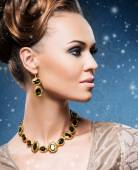 Woman with jewelries — Stock Photo