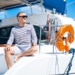 Young and handsome man on a sailing boat — Stock Photo #62287677