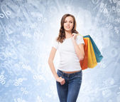 Happy woman with bright shopping bags — Stock Photo