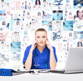Young medical worker feeling tired and stressed — Stock Photo