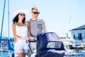 Lovely Caucasian couple walking with their baby — Stock Photo