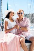Young and lovely couple relaxing on a boat — Stock Photo