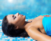 Beautiful woman in outdoor pool — Stock Photo