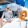 Man on sailing boat — Stock Photo #64396453