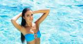 Woman in swimsuit near pool — Stock Photo