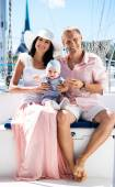 Family on sailing boat — Stock Photo