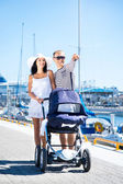 Young walking with baby outdoors — Stock Photo