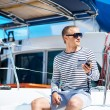 Handsome man on sailing boat — Stock Photo #67318393