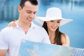 Couple exploring sea map — Stock Photo