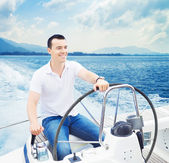 Young and handsome man sailing in sea — Stock Photo