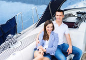 Couple relaxing together on boat. — Stock Photo