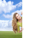 Girl with the blank banner. — Stock Photo