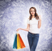 Happy teenage shopping girl with bags — Stock Photo