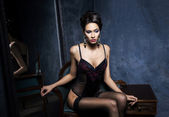 Young woman in sexy lingerie and stockings — Stock Photo