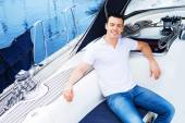 Handsome man relaxing on boat — Stock Photo