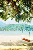 Swings on tropical beach — Stock Photo