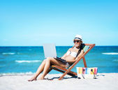 Woman with notebook on beach — Stock Photo