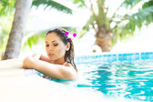 Woman relaxing in pool — Stock Photo