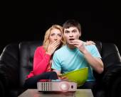 Family watching movie on laser projector — Stock Photo